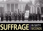 Women wearing sashes standing in front of White House with banners