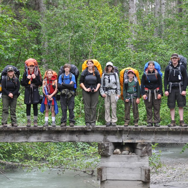 Line of guides and teens standing on a bridge