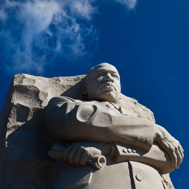 blue sky behind Martin Luther King statue