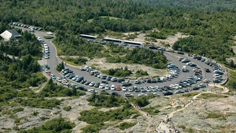Helicopter view of packed parking lot at the summit of Cadillac Mountain
