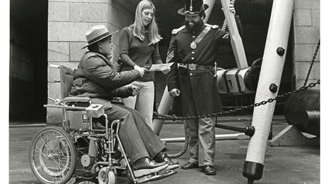 Woman in Wheelchair speaking to others circa 1980, Golden Gate