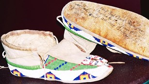 Red Cloud gave these signed, beaded moccasins to James Cook.