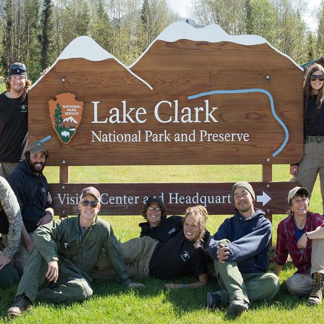A group of National Park Staff from Lake Clark National Park & Preserve pose in front of headquarter