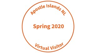 Orange text in a circle reading: Apostle Islands NL, Spring 2020, Virtual Visitor.