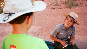 a ranger speaks with a child