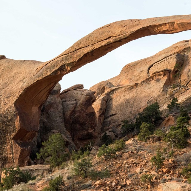 a broad, thin red rock arch