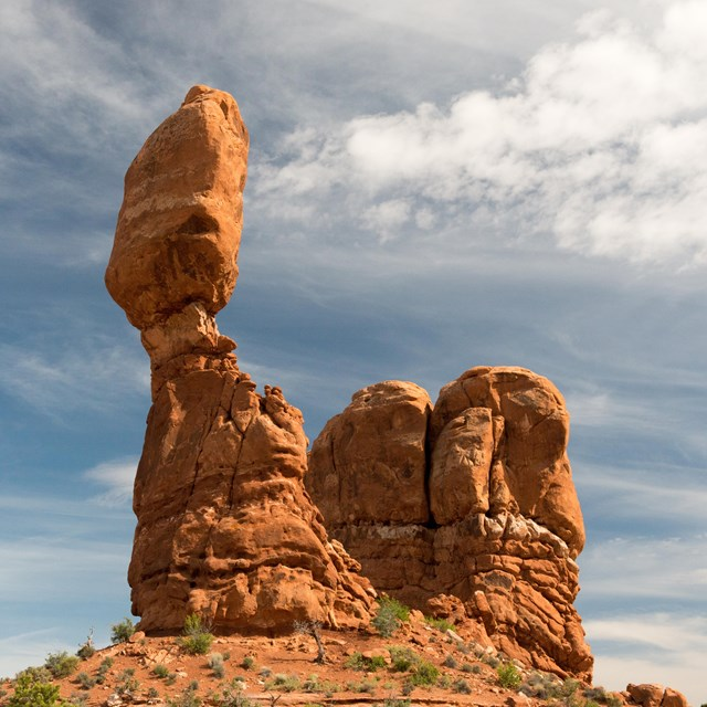 a tall, balanced rock