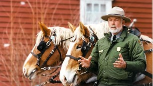 Image of Ranger Chuck with two horses