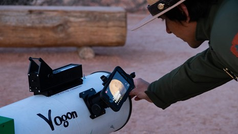 Ranger interacts with visitors through iPhone mounted to telescope