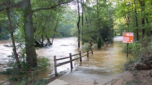 Flooded entrance road to Vickery Creek unit during the Flood of 2009.