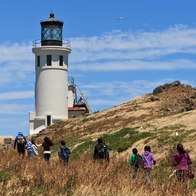 Visitors hiking towards lighthouse. ©Tim Hauf, timhaufphotography.com