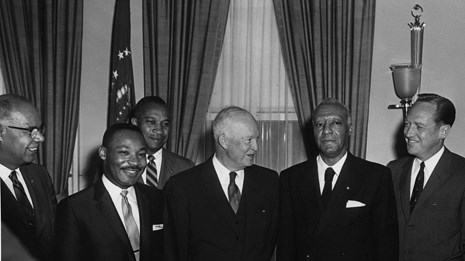 B&W photo of civil rights leaders standing next to President Eisenhower