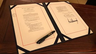 Signed law and pen on a desk