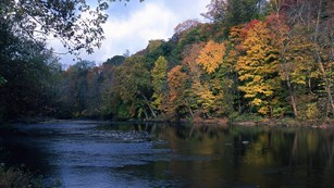 A landscape photo of the Cuyahoga River during autumn.