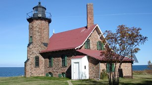 Stone house with a lighthouse tower attached