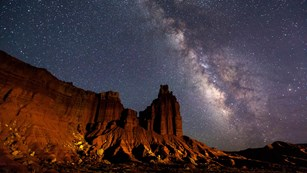 Milky Way over a red-rock cliff face
