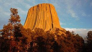 Devils Tower rock formation at sunset