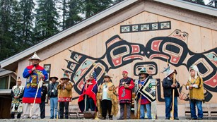 Huna tribal members in front of the Huna Tribal House