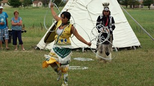 Sioux dancer holding hoops
