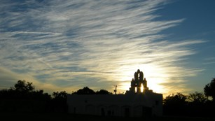 Sillouette of Mission San Juan at sunset.