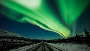 Northern lights over a roadway