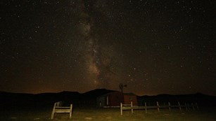 Milky Way over a fence and ranch