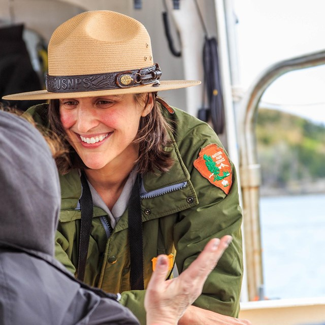 Park ranger smiling and sharing information