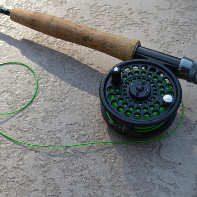 Close up of rod, reel, and line for fly fishing.