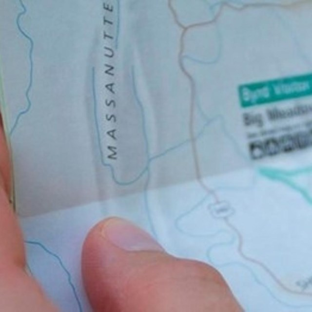 close up of person holding map.