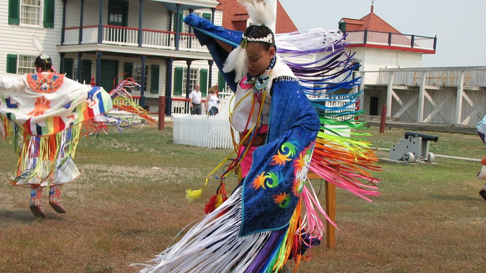 Woman in colorful shawl dances