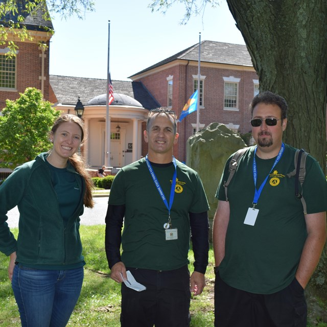 Two volunteers pose with the Delaware State Park Volunteer Coordinator.