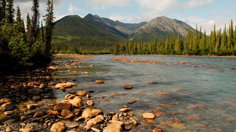 Mountains rise above black spruce forest and the North Fork Koyukuk River