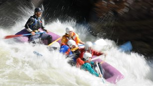 Raft going through a rapid
