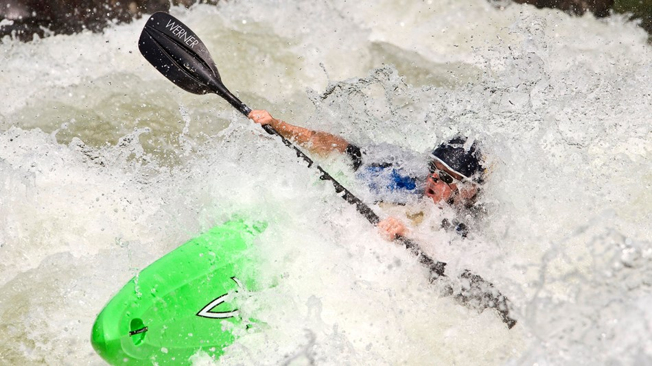 Kayaker paddling through a rapid on the Gauley River