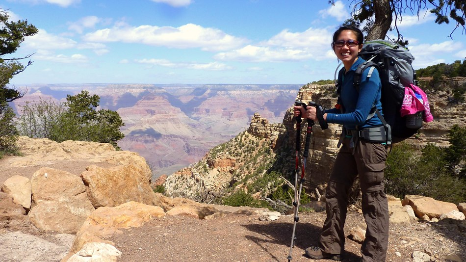 person standing near a Grand Canyon viewpoint