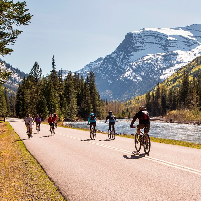 Visitors biking the road along McDonald Creek during hiker/biker season