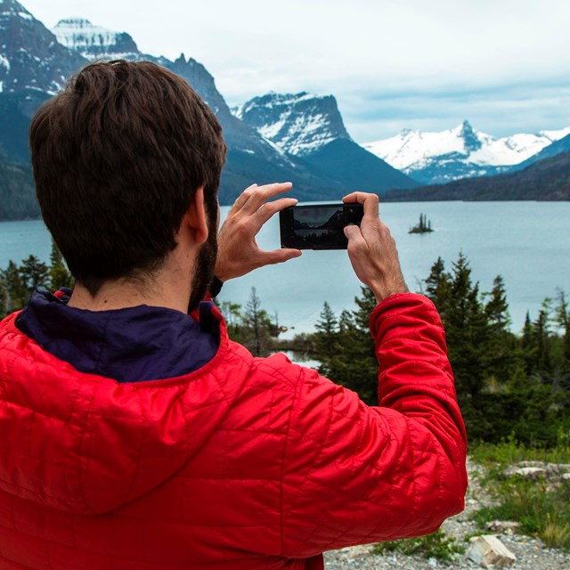 Visitor taking a photo of Wild Goose Island