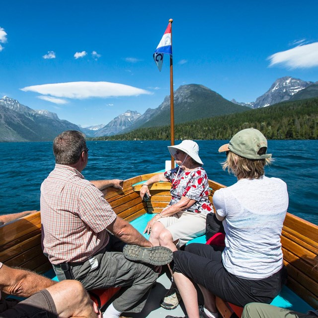 Visitors enjoying a boat tour of Lake McDonald