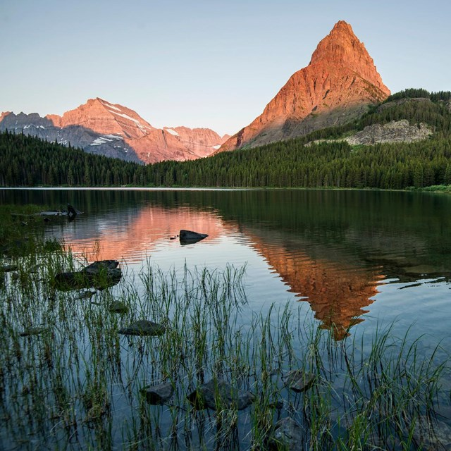 First light on Ginnell Point over Swiftcurrent Lake