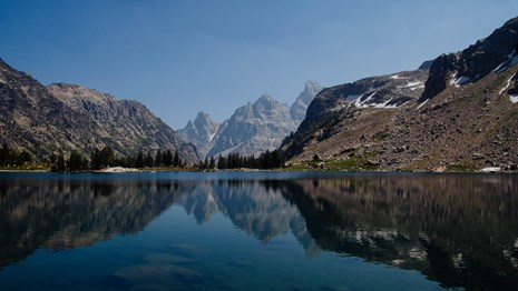 Mountains reflected in an alpine lake.