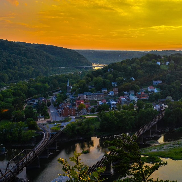 View from above the Potomac River of the town of Harpers Ferry at sunset.