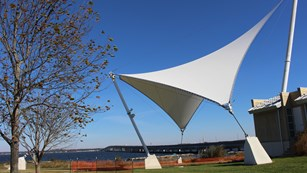 Deep blue skies outside the Dorchester County Visitor Center, with sail-reminiscent figure in front