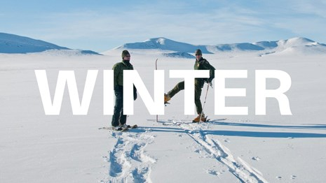 word Winter over background of a skier and snowshoer
