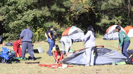A group taking down their tents