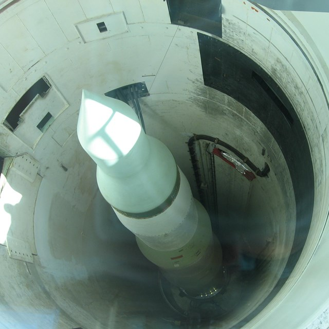 image of missile in silo from Minuteman Missile NHS. Photo By Spencer - Own work, CC BY-SA 3.0.