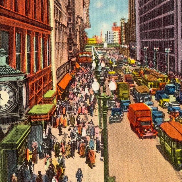 Postcard of historic Chicago street with cars and shops lining the street.