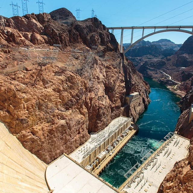 Image of Hoover Dam looking down into the water. CC0