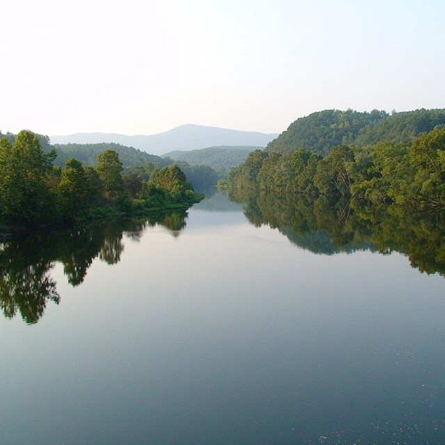 image of river with mountains in background. CC0.