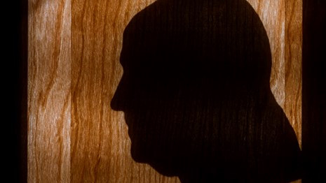 Color photo showing a silhouette of Benjamin Franklin in profile.
