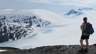 Woman looking over the Harding Icefield